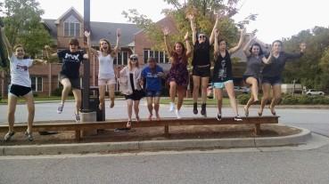 12th Grade Girls in mid-jump