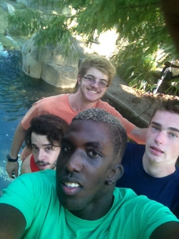 12th Grade Guys standing in a fountain