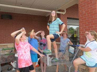6th Grade Girls saluting the shopping cart