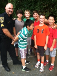 6th Grade Guys with a policeman, getting handcuffed