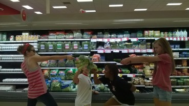 9th Grade Girls doing a Harry Potter battle with vegetables